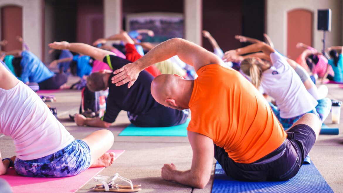 why wellness programs matter - employees doing yoga together